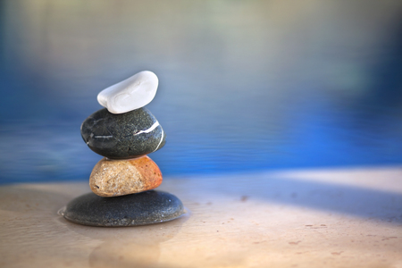 successively: Different pebbles are standing successively near the pool