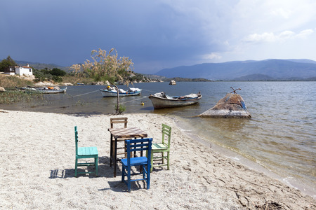characteristic: Characteristic restaurant table and chair on coast of the lake