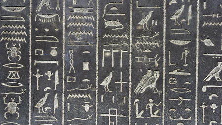 Historical Egyptian hieroglyphs on the wall Stock Photo
