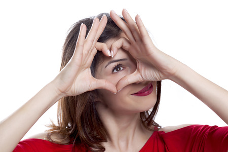 hand signal: Heart shaped hand signal of a beautiful young  woman Stock Photo