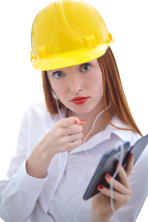 headed: Long haired red headed woman using a cellphone and wearing a safety hat