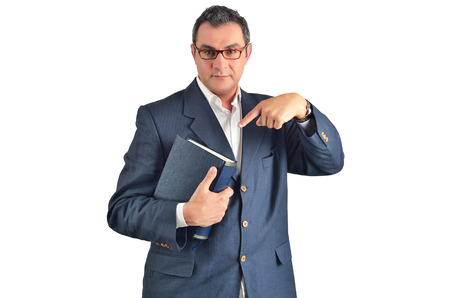 Businessman holding a book isolated on white background