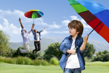 flying man: Happy family is flying with colorful umbrella on nature