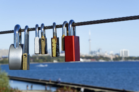 Padlocks hang on steel rope for wishing love or marriage Stock Photo