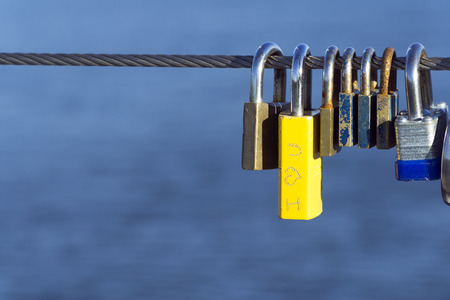 Padlocks hang on steel rope for wishing love or marriage Stock Photo - 65219258