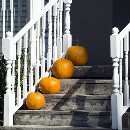 Pumpkins on steps for Halloween holiday Stock Photo