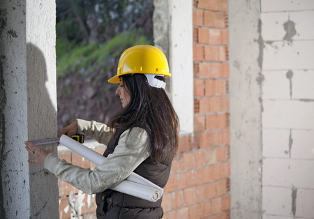 Young architecture woman in a construction Stock Photo - 71560525