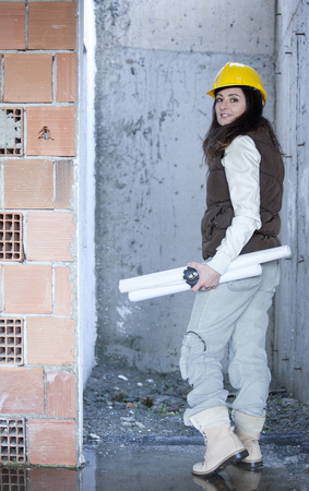 Young architecture woman in a construction Stock Photo - 71561549