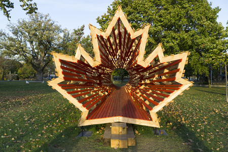 Wooden Canada flag's icon maple tree leaf Stock Photo - 80023787