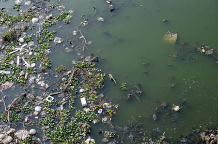 wastrel: dirty water have many float garbage Stock Photo
