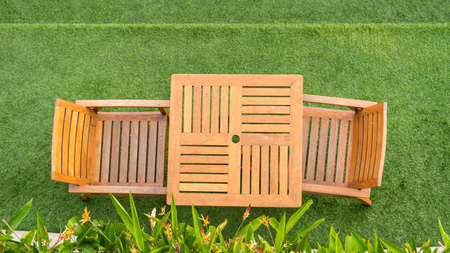 lawn chair: wood table and chair table on grass