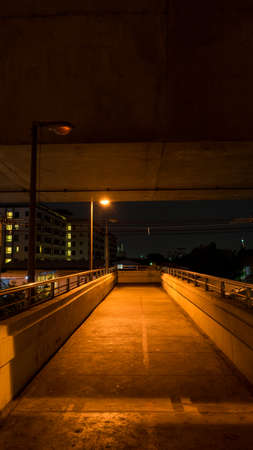 outage power: overpass in night it dark because glimmer bulbs Stock Photo