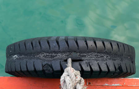 cushioning: rubber beside boats intended for cushioning the port