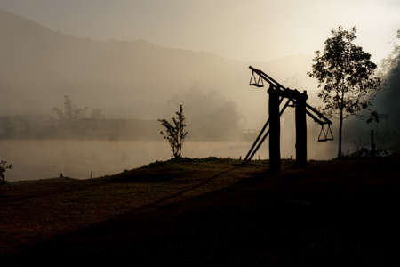 acrophobia: Silhouette of wood ferris wheel at sunrise