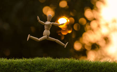 wooden dummy jumping have feeling happiness
