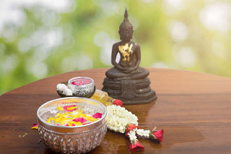 flower float water in bowl for bath buddha statue, songkran festival in thailand