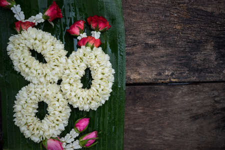 three garland on banana leaf for worship about various festival in thailand Stock Photo