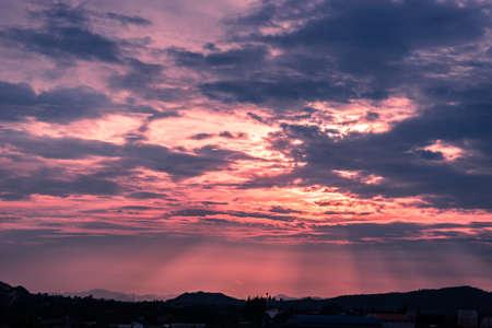 thru: sun beam shine thru cloud to ground in evening