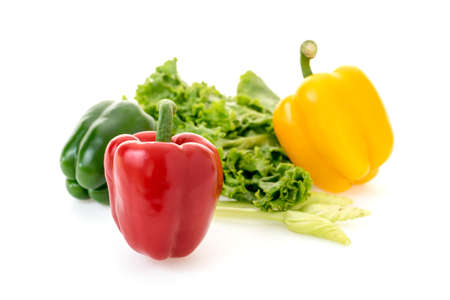 yellow pepper and vegetable group on white background