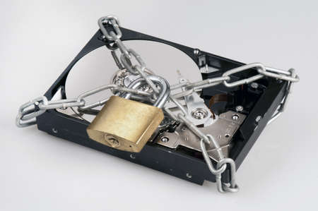 Hard disk secured with a chain and lock Stock Photo - 13555528