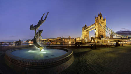 Panorama of Tower Bridge and a nearby sculpture, London