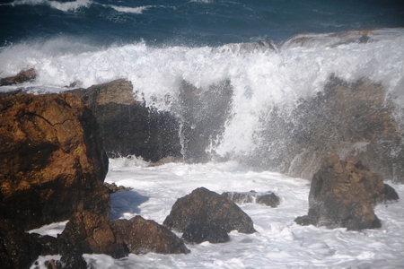wind force: Waves on the rocks Stock Photo
