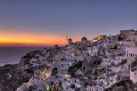 Oia Sunset in Santorini, Greece photo