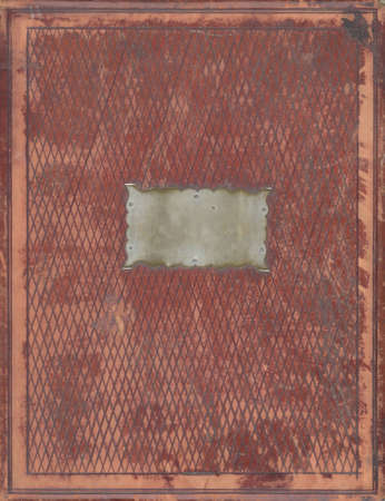vintage leather book cover with blank metal plate photo