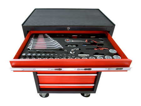 red toolbox on wheels with open tray isolated on white Stock Photo