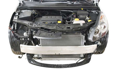 radiator: dismantled front of a car over white background