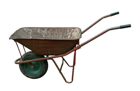 old used vintage rusted wheelbarrow Stock Photo