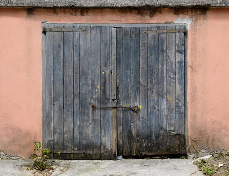 locked the door locked: old weathered wooden garage door Stock Photo