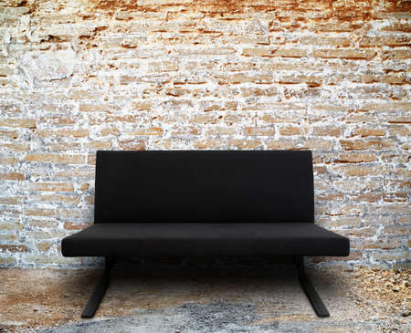 modern sofa in old brick wall room setting photo