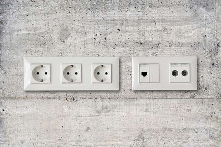 electric ethernet and antenna socket on concrete wall