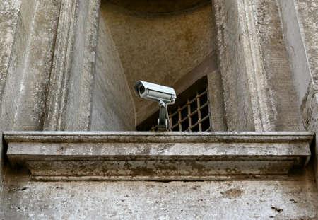 surveillance camera on old building photo
