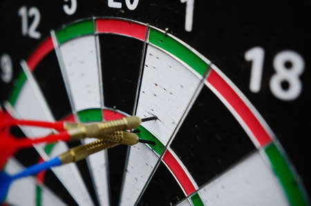 missed: darts missing the right target close up