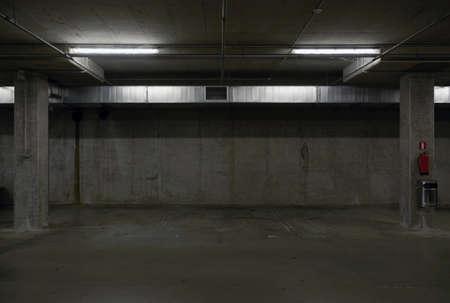 underground dark parking garage empty parking spaces photo