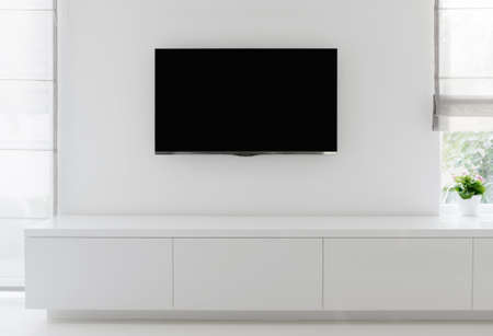 luxury living room: white living room detail tv on wall with commode and epoxy flooring