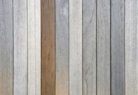 oiled: old dried weathered teak decking planks in row and one oiled Stock Photo