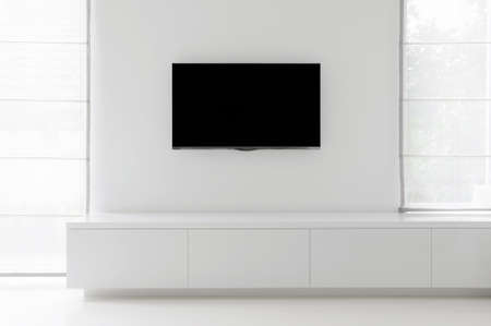 living room furniture: white living room detail tv on wall with commode and epoxy flooring