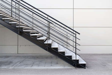 metal handrail: detail of industrial iron stairs in exterior