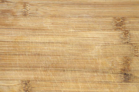 bamboo texture: used scratched bamboo wood cutting board background detail Stock Photo