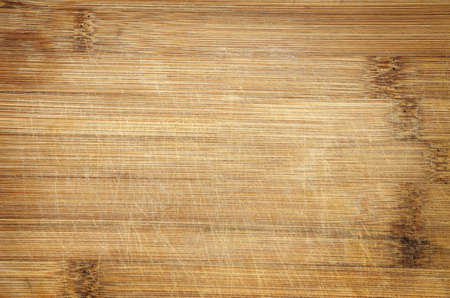 used scratched bamboo wood cutting board background detail Stock Photo