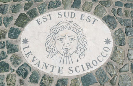 image of sirocco wind sign in marble  on cobblestone floor