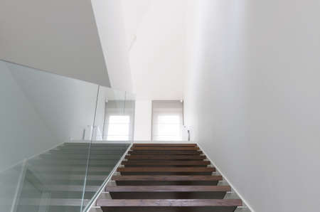 hardened: wooden staircase and hardened glass balustrade Stock Photo