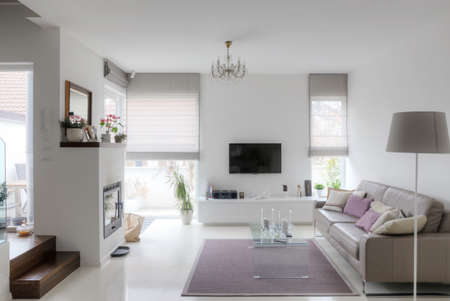 epoxy: modern living room with taupe sofa glass table and fireplace