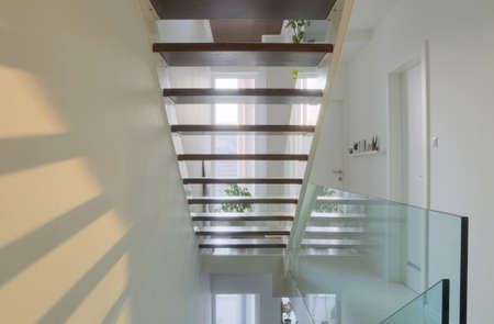 see trough stairs modern house interior hall Stock Photo