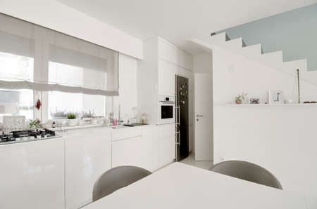 image of white kitchen with table detail