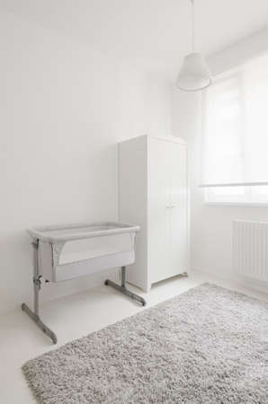 babyroom: modern white baby room with crib and closet
