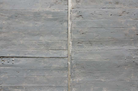 gray painted old weathered wooden door detail background